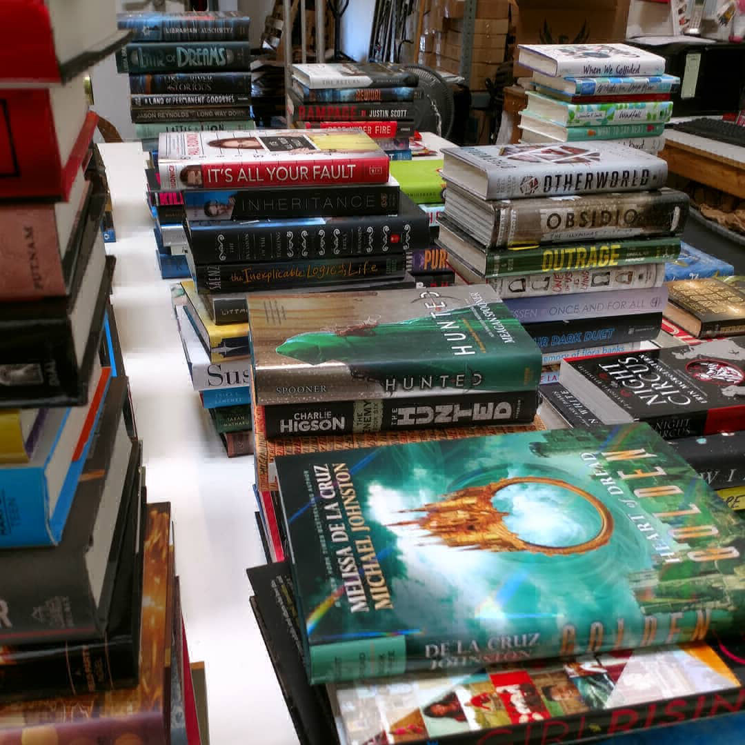 Table full of books being sorted