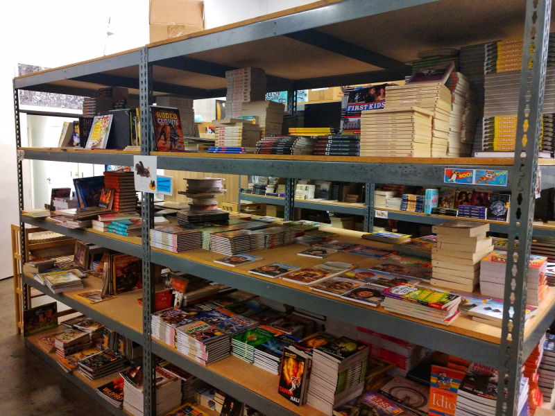 warehouse shelves with non-fiction books